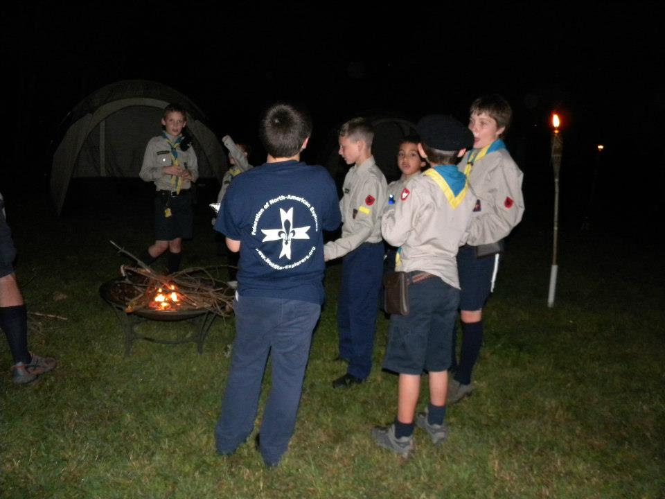 After Mass, the boys have a snack and get ready for the campfire