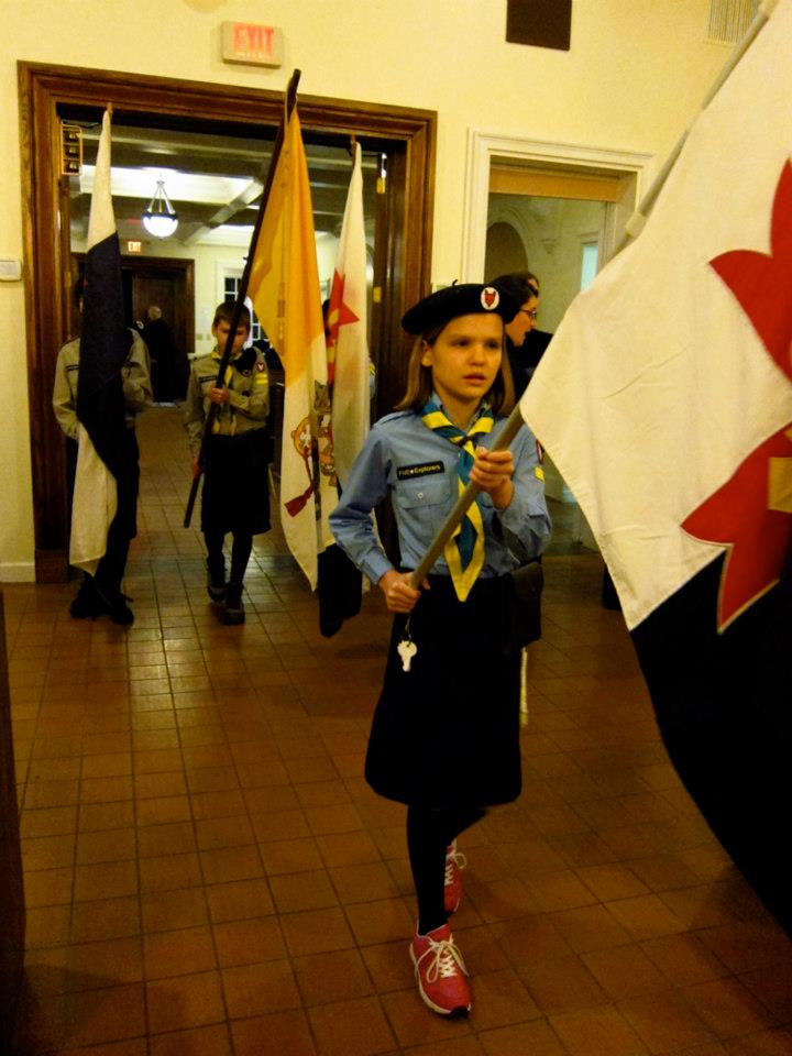 Timber Wolves following their brothers and sisters into church, carrying the flags of our movement and the Papal flag