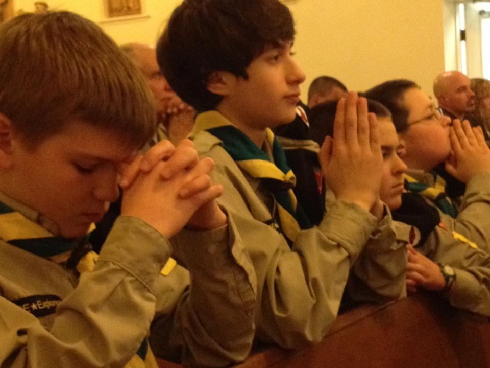 Timber Wolves praying during Holy Mass