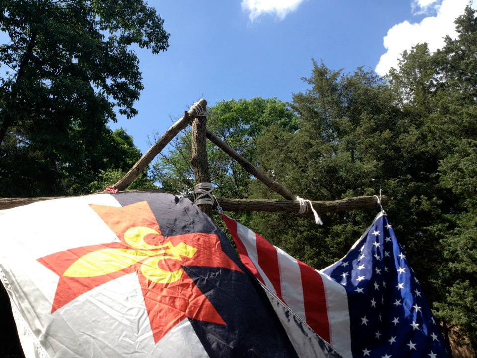 Raising flags over camp