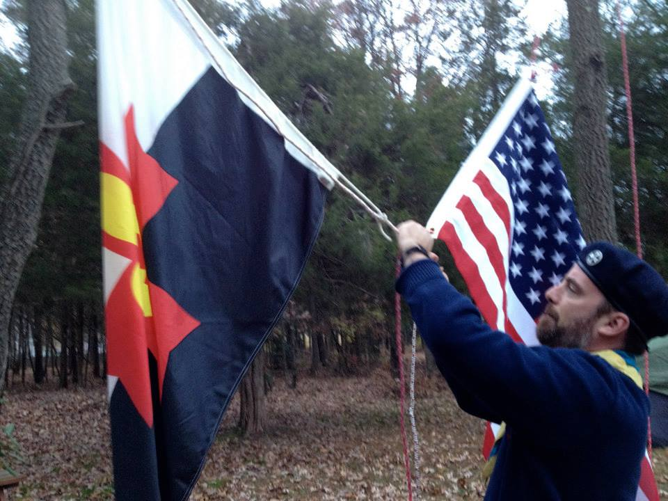 Raising the flags at Camp St. Michael