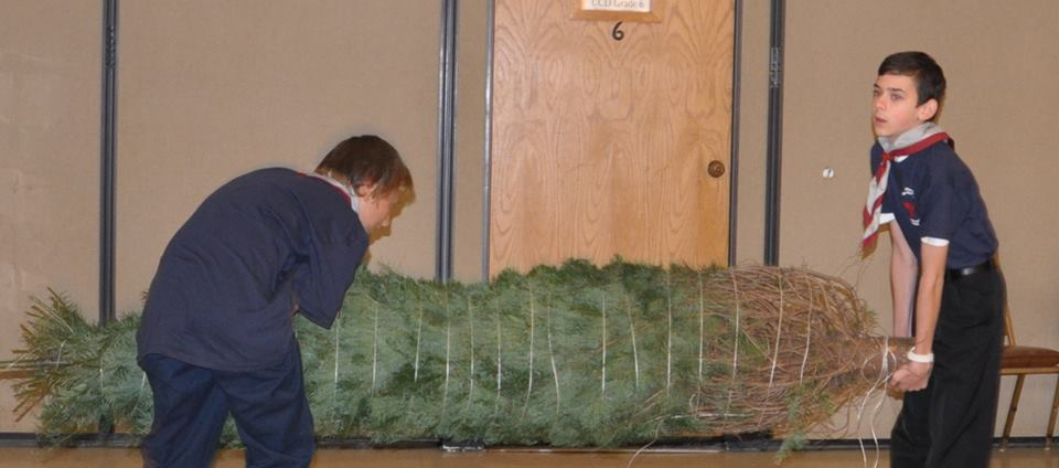 Helping parishioners with their Christmas trees