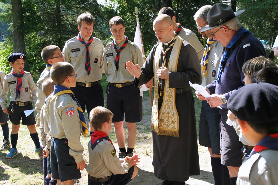 Fr. Beaugrand blesses Timber Wolf